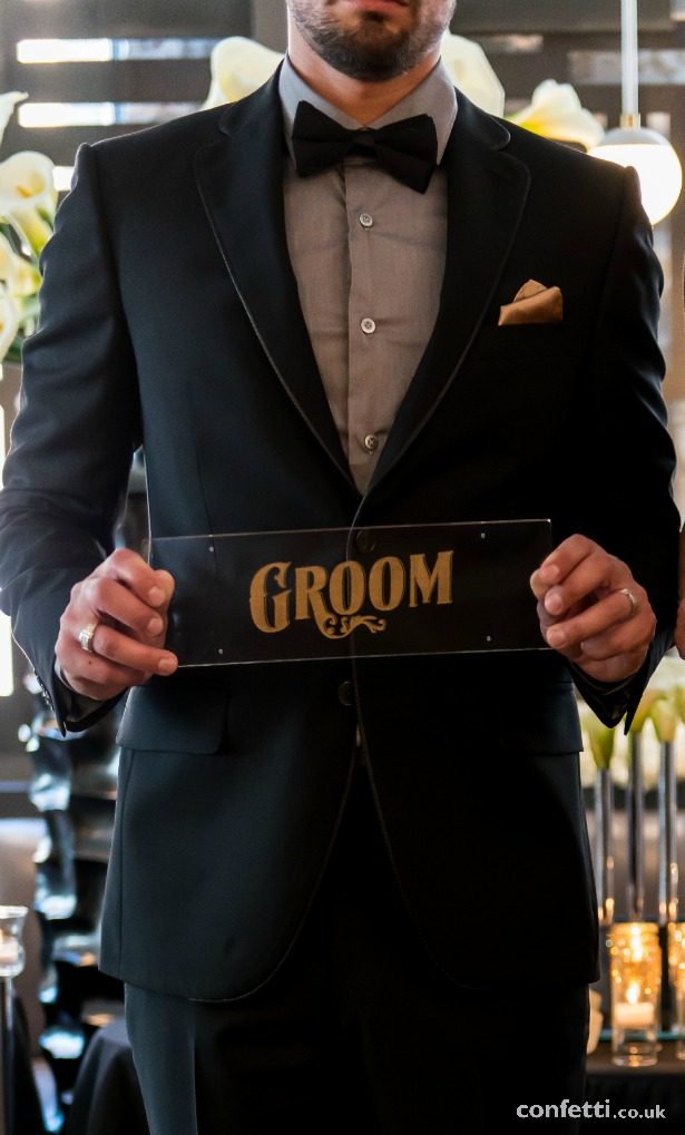 Fashion for the groom with black and gold opulance sign | Confetti.co.uk