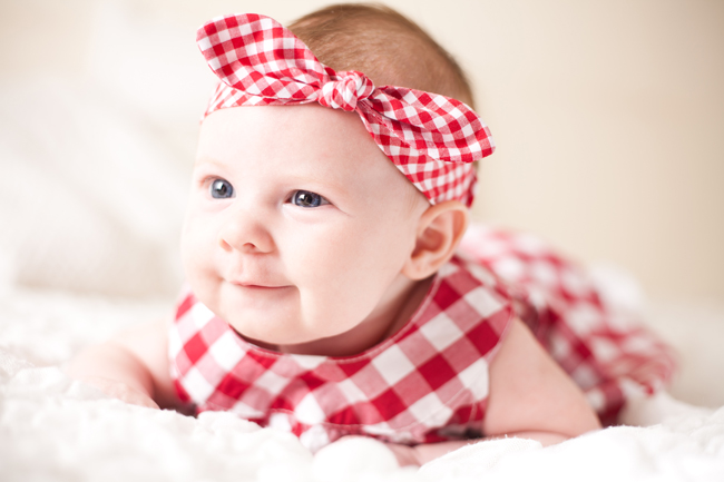 Baby girl with red bow