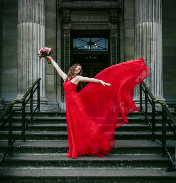 Bride in red dress by Fabulous Wedding Photography | Confetti.co.uk