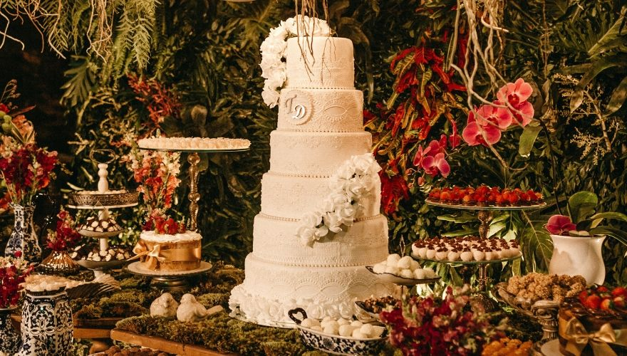 Traditional wedding cake made of several white iced tiers