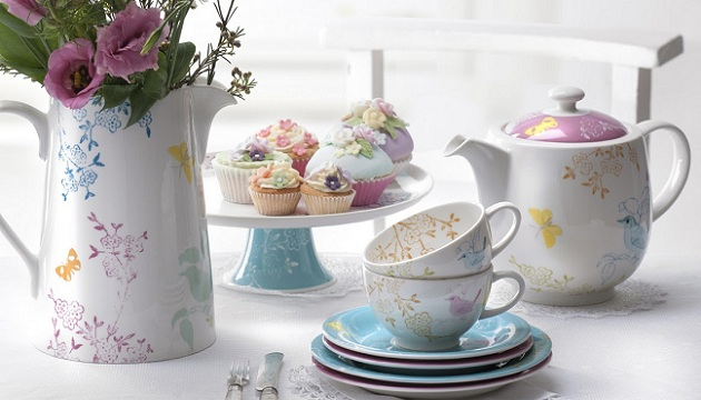 Colourful teacups teapot vase flowers cupcakes