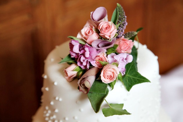Beautiful White Icing Wedding Cake with Pretty Pink and Lilac and Ivy Decorative Topper