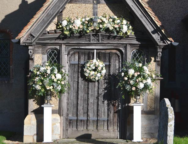 Church door flowers by The Bespoke Florist | Confetti.co.uk