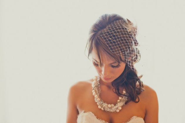 Pretty bride wearing veil and jewellery