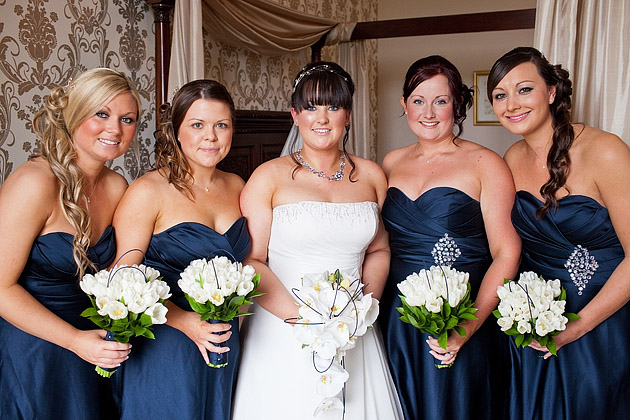 bride and bridesmaids in navy blue