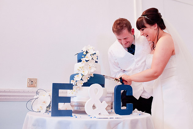 bride and groom cutting modern wedding cake