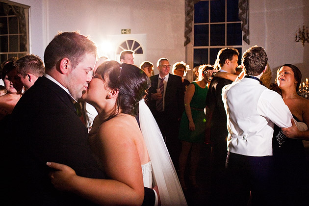 Bride and groom kissing on dancefloor