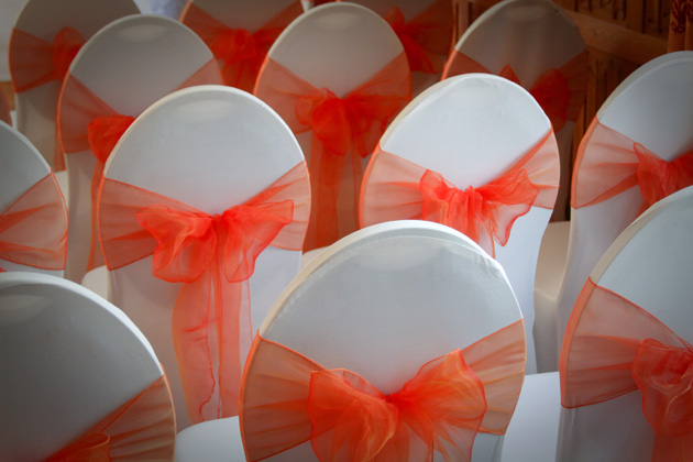 Orange chair sashes