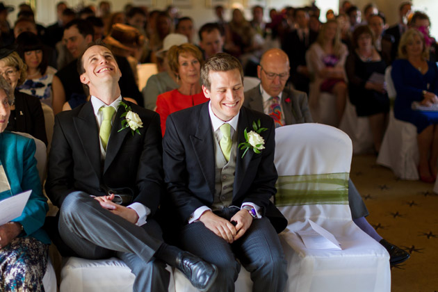 Groomsmen Laughing At Wedding Ceremony