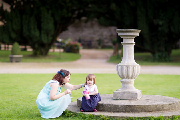 Wedding Guest With Little Girl by the Fountain