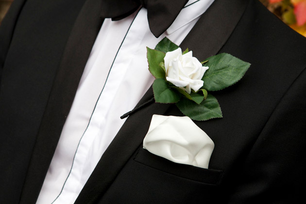 Groom's White And Green Boutonniere