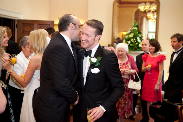 Groom Receives Congratulations From Guests