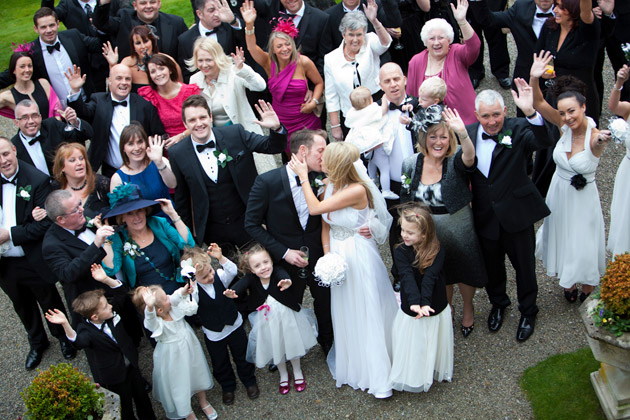 Bride and Groom With Guests Outside