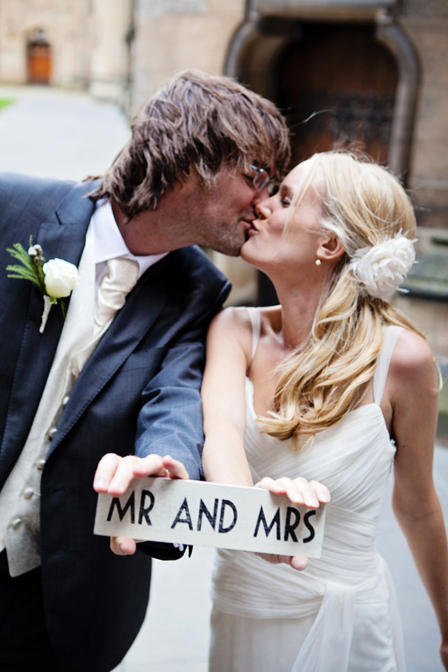 Bride And Groom With Mr & Mrs Sign