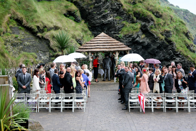 Groom and Guests Wait for Bride