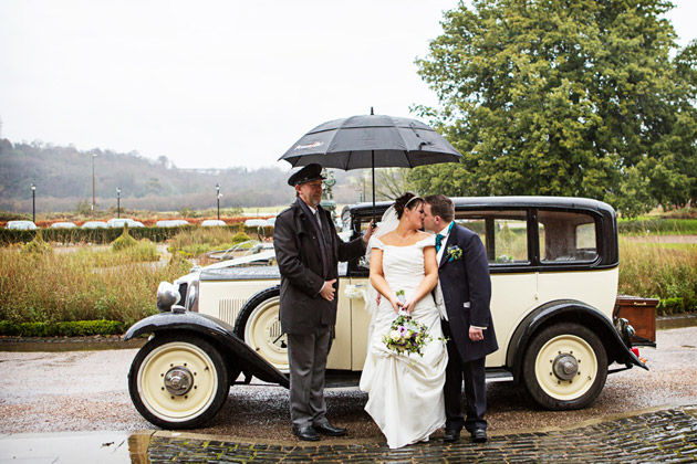 Bride And Groom With Brolly and Chauffeur