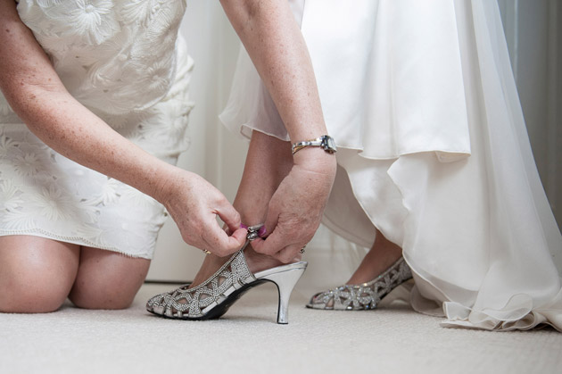 Mother of the Bride Helps Bride With Shoes