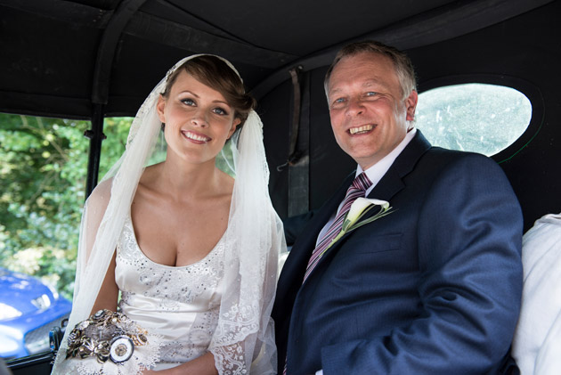 Bride and Father of the Bride in Car