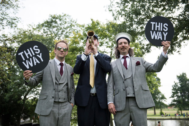 Groomsmen Call Guests to Boat