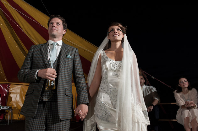 Bride and Groom Watching Band Onstage