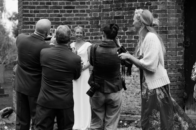 Guests Taking Photos of the Bride
