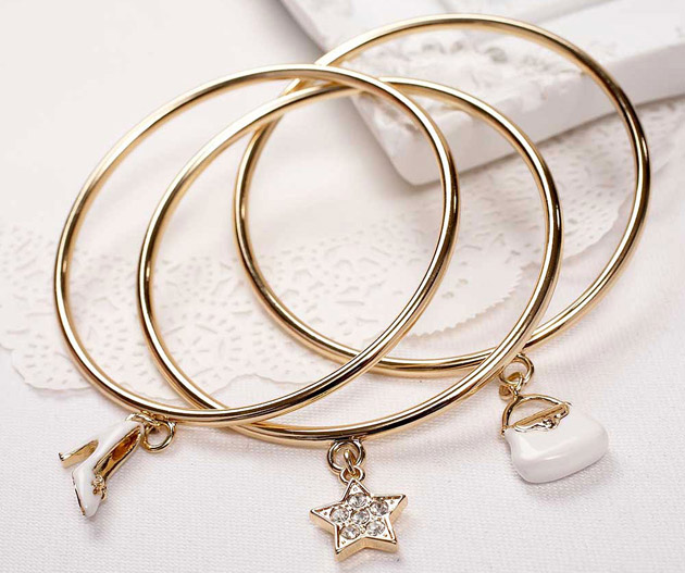 3 Gold Bangles with Charms