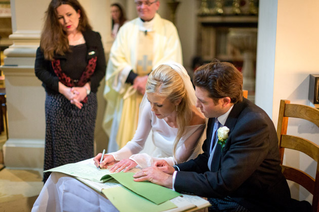 Newlyweds Sign the Register