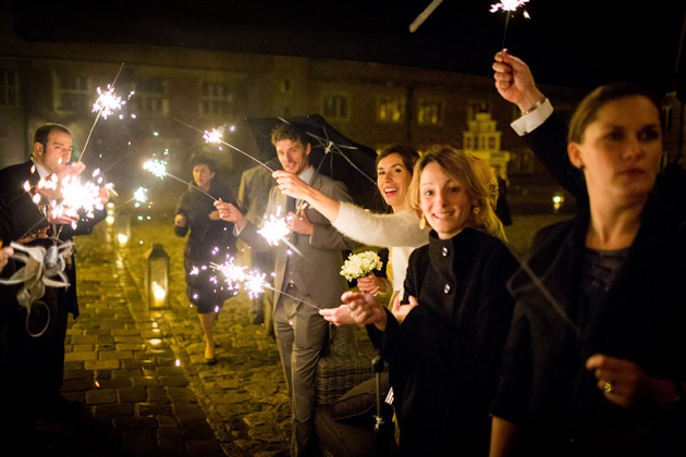 Guests wit Sparklers Waiting for Newlyweds