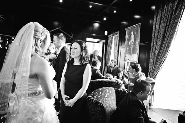 Bride Chatting with Guests at Reception