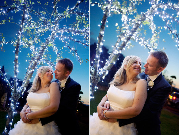 Bride and Groom Outside Under Glittering Tree