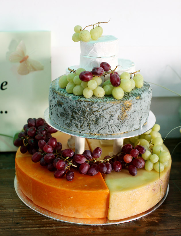 Cheese wedding cake with grapes