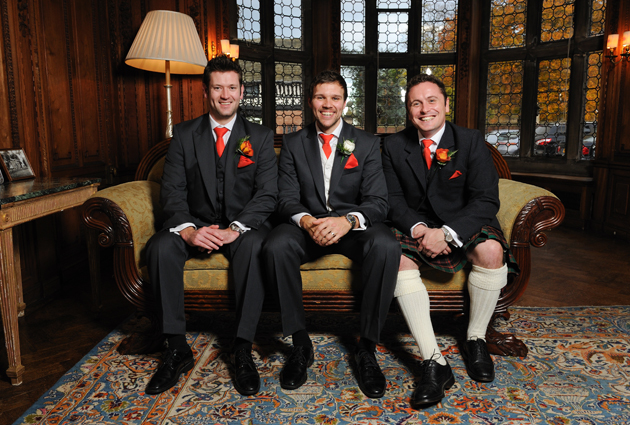 Groom and Grooms-men wearing orange ties