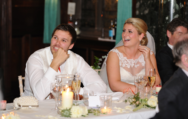 Bride and Groom Listen to Speeches