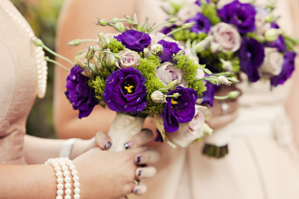 Bridesmaid's purple bouquets