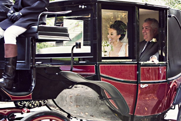 Bride in wedding horse and carriage