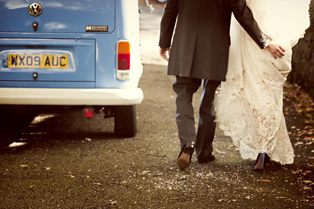 Newly weds and their wedding campervan