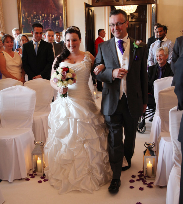 Bride at ceremony with father