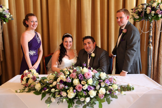 Newlyweds with chief bridesmaid and best man