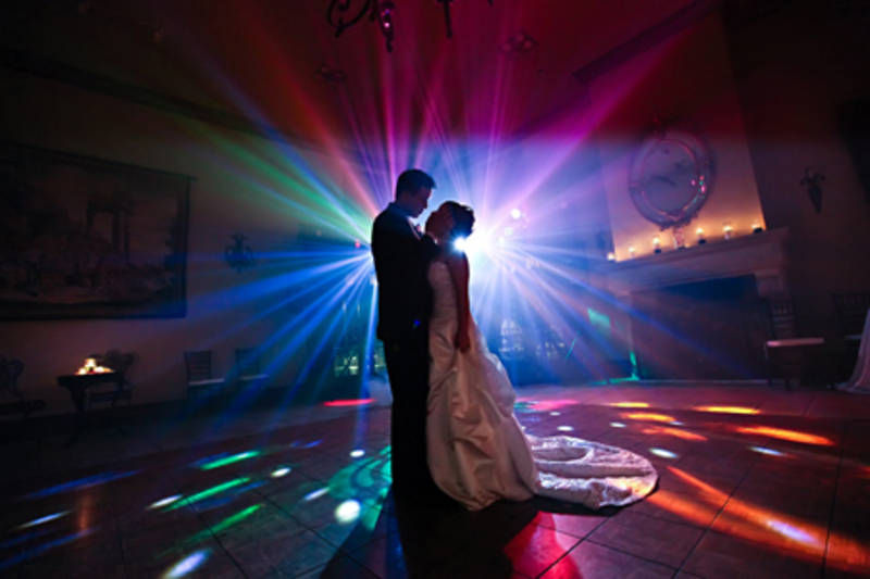 bride and groom first dance colourful lights