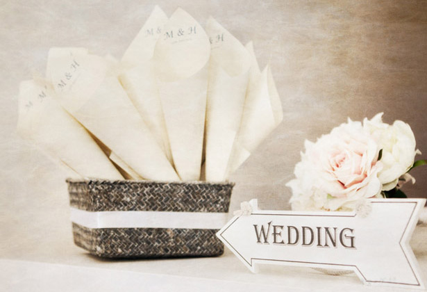 Confetti cones and wedding arrow sign