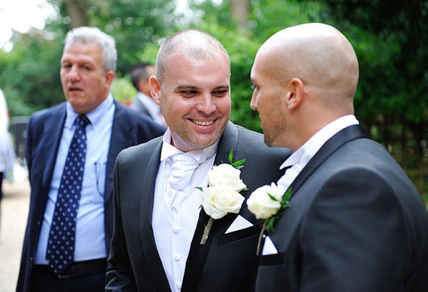 Grooms and bestman outside the church