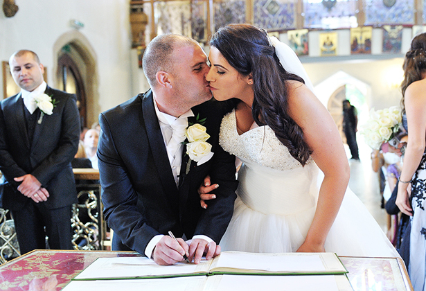 Newlyweds signing the register