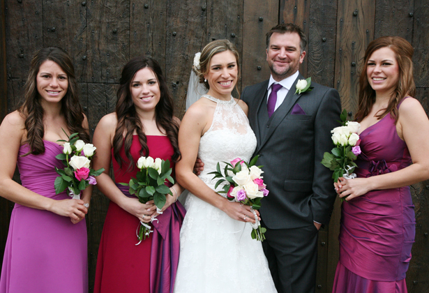 The newlyweds with their bridesmaids