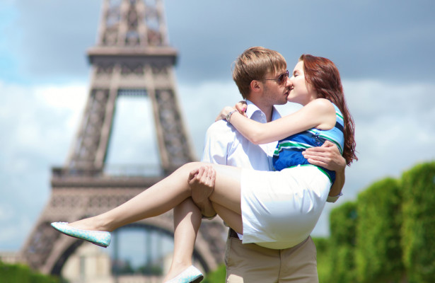 Couple in Paris embracing after romantic proposal