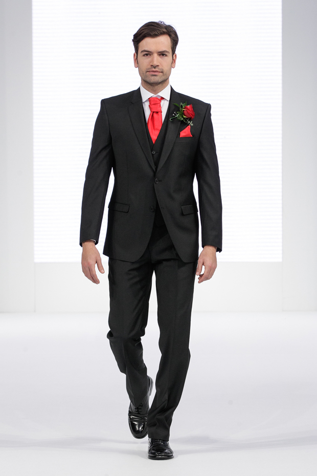 Contemporary designer menswear for the groom with red wedding colour scheme
