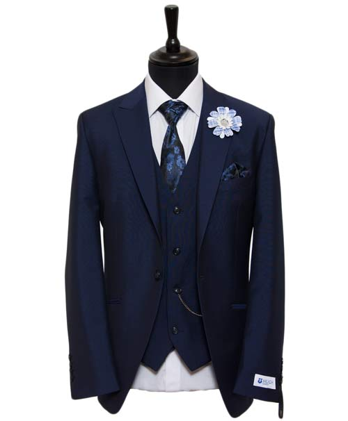 Navy blue suit for the groom with waistcoat by Hugh Harris