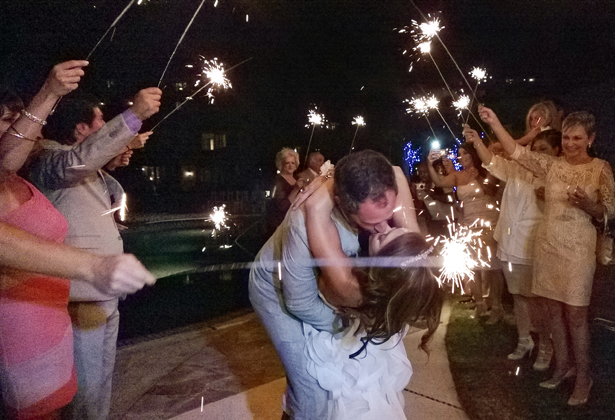 Guests with sparklers to celebrate the big day