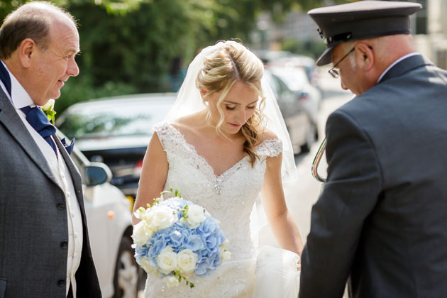 The bride arriving at the venue