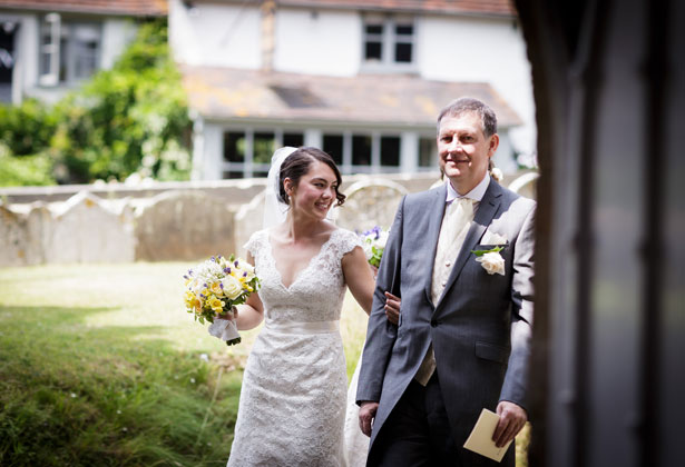 Bride with her father making their entrance in to the church