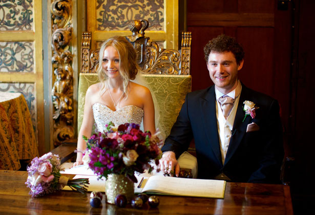 The newlyweds signing the register
